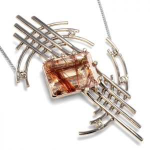 18ct white gold pendant with red rutilated quartz and diamonds