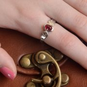 silver ring with garnet and blue diamonds