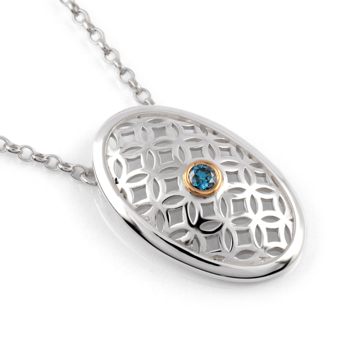 sterling silver oval pendant with blue diamond