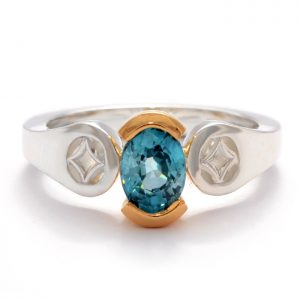 sterling silver ring with 18ct gold accent and zircon