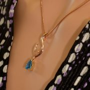 9ct rose and yellow gold pendant with blue topaz