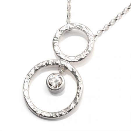 sterling silver pendant with circles and white cz