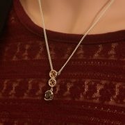 sterling silver circle pendant with garnet